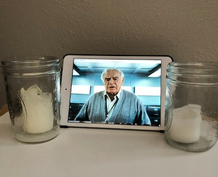 Image of shrine with two candles and an image of Ernest Borgnine from the movie RED